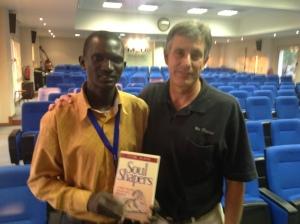 Isaac Atem Thon Atem and Jim Roy.