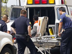 A 15 year old boy is loaded into an ambulance at the Maui airport.