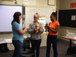 Class members demonstrate how puppets can be used to help students learn about choice theory and process their behavioral choices. (From the summer class at PUC, 2014)