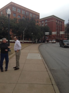 Taken from the sidewalk next to the grassy knoll; Gale and Dan in the foreground.