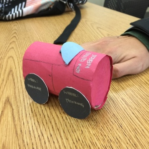 A total behavior car made from a paper towel tube. (Created for one of the Ethical Dimensions assignments.)