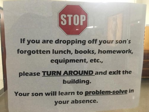 Sign on the front door at a Catholic high school for boys in Little Rock, Arkansas.